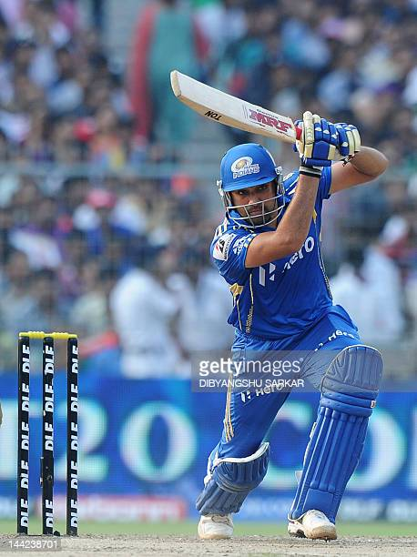 Mumbai Indians batsman Rohit Sharma plays a shot during the IPL Twenty20 cricket match between Kolkata Knight Riders and Mumbai Indians at The Eden...