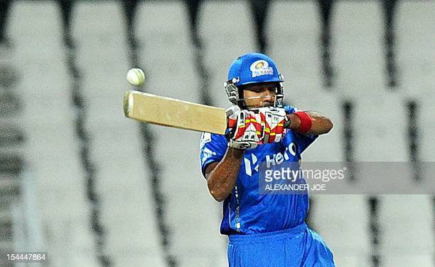 Mumbai Indians batsman Rohit Sharma plays a shot on October 20 2012 during a Group B Champions League T20 match against Chennal Super Kings at...