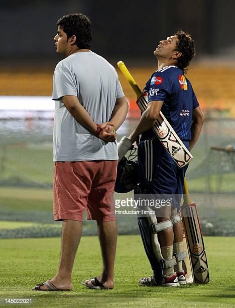 Mumbai Indians Batsman Sachin Tendulkar with Anant Ambani son of Mukesh Ambani and owner of Mumbai Indians during the team practice session at M...
