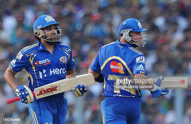 Mumbai Indians batsmen Rohit Sharma and Herschelle Gibbs run between wickets during the IPL Twenty20 cricket match between Kolkata Knight Riders and...