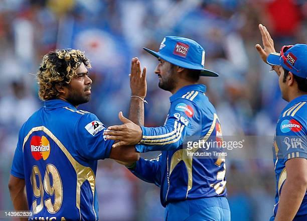 Mumbai Indians bowler Lasitha Malinga celebrates with captain Harbhajan Singh after the dismissal of Chennai Super Kings batsman Ravichandran Aswin...