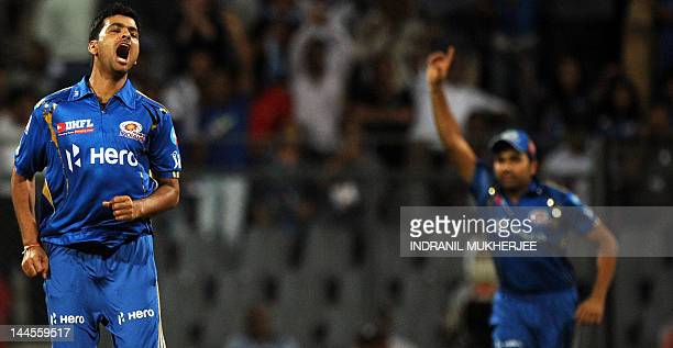 Mumbai Indians bowler Rudra Pratap Singh reacts as teammate Rohit Sharma celebrates after the dismissal of unseen Kolkata Knight Riders batsman...
