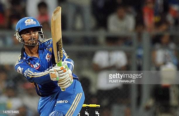 Mumbai Indians captain Harbhajan Singh plays a shot during the IPL Twenty20 cricket match between Mumbai Indians and Delhi Daredevils at the Wankhede...