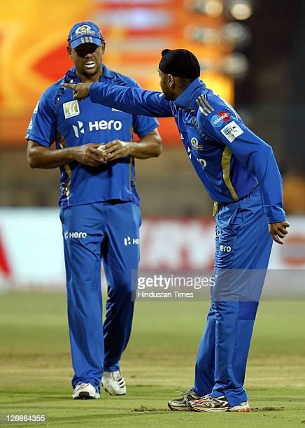Mumbai Indian's captain Harbhajan Singh points towards the pavillion as Andrew Symonds looks on during the Champions League Twenty20 Group A match...