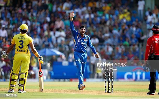 Mumbai Indians captain Harbhajan Singh unsucessfully appeal against Chennai Super Kings batsman Dwayne Bravo during their IPL T20 match between...