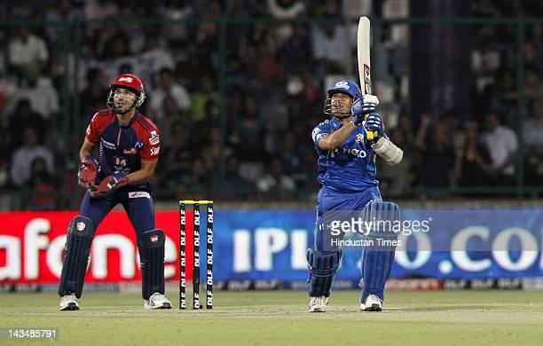 Mumbai Indians player Sachin Tendulkar plays a shot during IPL 5 T20 cricket match played between Delhi Daredevils and Mumbai Indians at Ferozshah...
