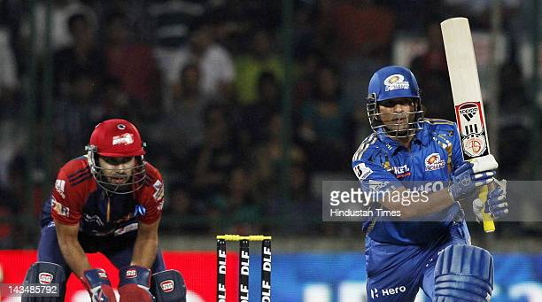 Mumbai Indians player Sachin Tendulkar plays a shot during IPL 5 T20 cricket match played between Delhi Daredevils and Mumbai Indians at Ferozshah...