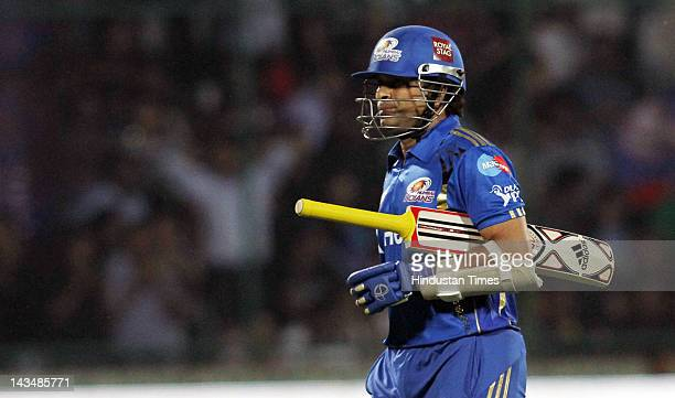 Mumbai Indians player Sachin Tendulkar returning to pavilion after getting out during IPL 5 T20 cricket match played between Delhi Daredevils and...