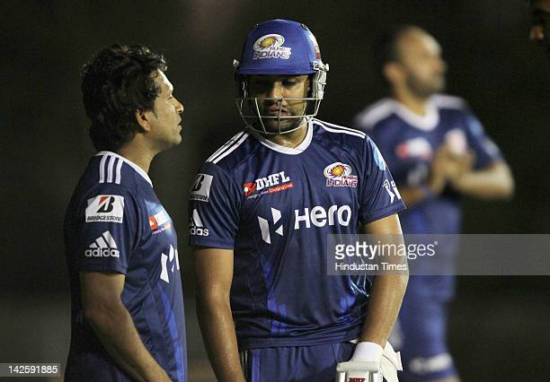 Mumbai Indians player Sachin Tendulkar talking with teammate Rohit Sharma during the practice session of Mumbai Indians at YSR Stadium on April 8...