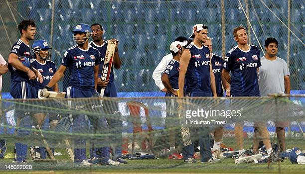 Mumbai Indians players along with Anant Ambani son of Mukesh Ambani and owner of Mumbai Indians during the team practice session at M Chinnaswamy...