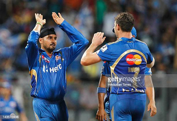 Mumbai Indians players Harbhajan Singh and James Franklin celebrate the wicket of Deccan Chargers player Daniel Christian during IPL 5 T20 cricket...