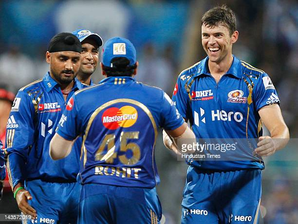 Mumbai Indians players Harbhajan Singh Rohit Sharma and James Franklin celebrate the wicket of Deccan Chargers player Daniel Christian during IPL 5...