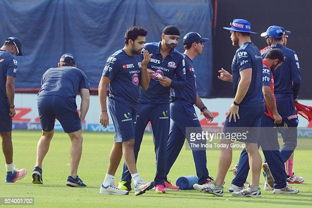 Mumbai Indians players Rohit Sharma with Harbhajan Singh during the practice session at Feroz Shah Kotla Ground in New Delhi