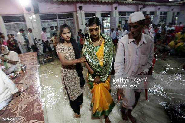 Mumbai Monsoon MONSOON WEDDING Even rains could not stop Nutan Salunkhe the bride to marry Santosh Kadam at a hall submerged under water near Nehru...