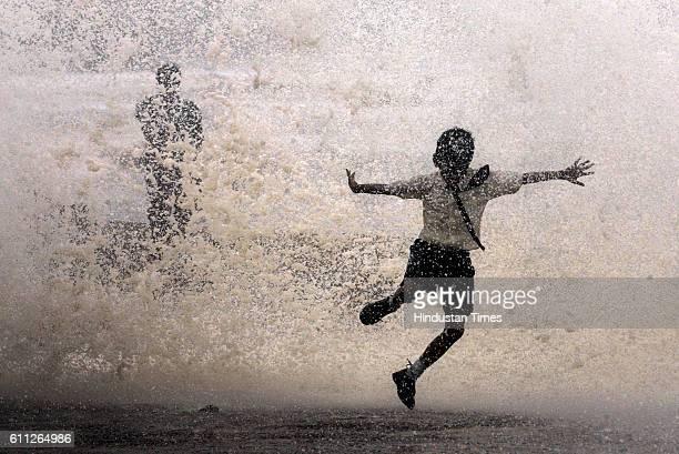 Mumbai Monsoon Rain High Tide A school boy enjoy getting wet in tidal waves at Worli Seaface on Tuesday