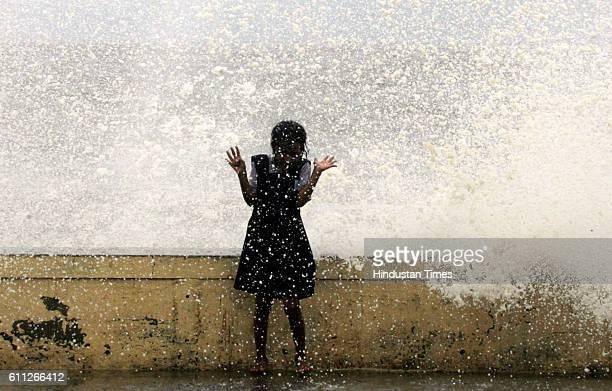 Mumbai Monsoon Rain High Tide A school girl enjoys getting wet in tidal waves at Worli Seaface on Tuesday