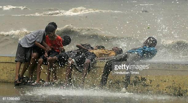 Mumbai Monsoon Rain High Tide Kids enjoy getting wet in tidal waves at Worli Seaface on Tuesday