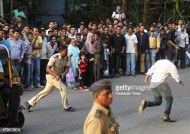Mumbai police control the crowd of fans gathered to catch glimpse of Bollywood actor Salman Khan outside his Bandra residence after Bombay High Court...