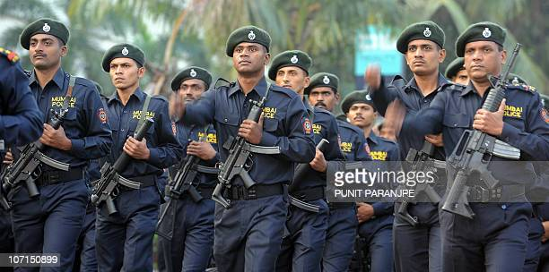 Mumbai policemen march during a parade to commemorate the second anniversary of the November 2008 terror attacks in Mumbai on November 26 2010 A...