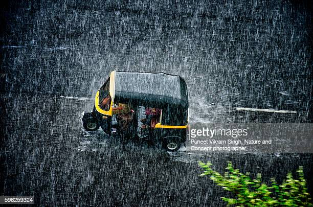 mumbai rain - auto rickshaw stock pictures, royalty-free photos & images