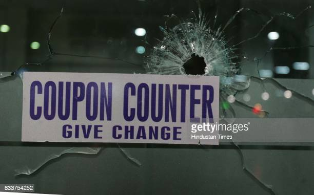 Bullet shot is seen at coupon counter