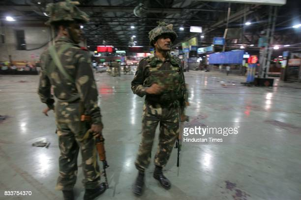 Commandos stand guard at a deserted Chhatrpati Shivaji Terminus CST on Thursday