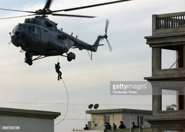 Military personnel abseiling from a helicopter Special forces stormed a Jewish centre in Mumbai Friday as part of efforts to end a hostage crisis and...