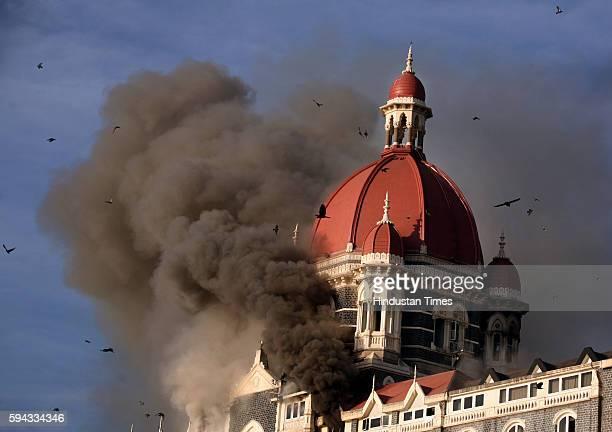 26/11 Mumbai Under Terror Attack Firing at Taj Hotel Smoke belching out from below the main Dom of Taj Hotel on Thursday Morning