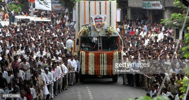 Mumbai under Terror attack Hemant Karkare Funeral Police and local people escort a vehicle carrying the body of Hemant Karkare chief of the police...
