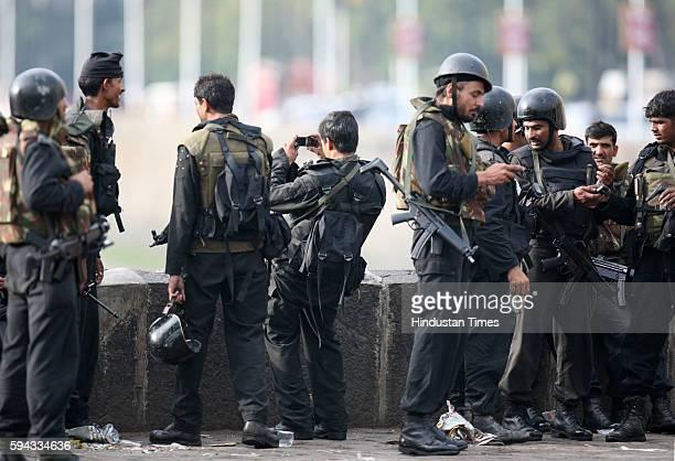 Mumbai under Terror attack NSG National Security Guard Commandos taking photo after a successful operation at the Taj Mahal Hotel in Mumbai