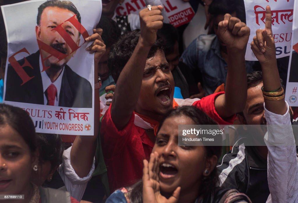 Mumbai Youth Congress and Mumbai NUSI members organise a 'Bheek Mango Andolan', begging the university to declare results of the students at Mumbai University, Kalina Campus, on August 22, 2017 in Mumbai, India.