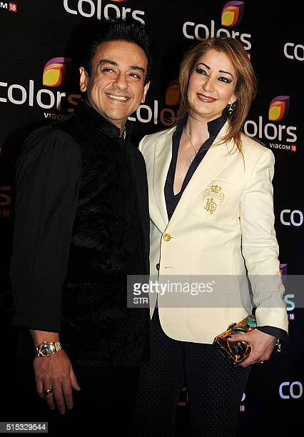 Mumbaibased Indian singer and musician Adnan Sami poses with his wife Roya Faryabi as they attend The Colors Television Annual Party in Mumbai late...