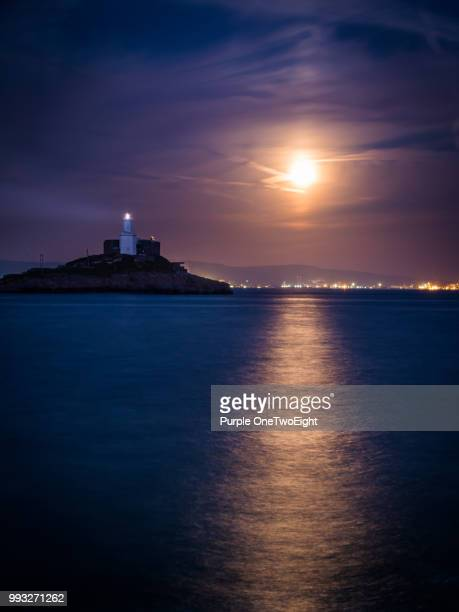 mumbles moonrise - mumbles stock photos and pictures