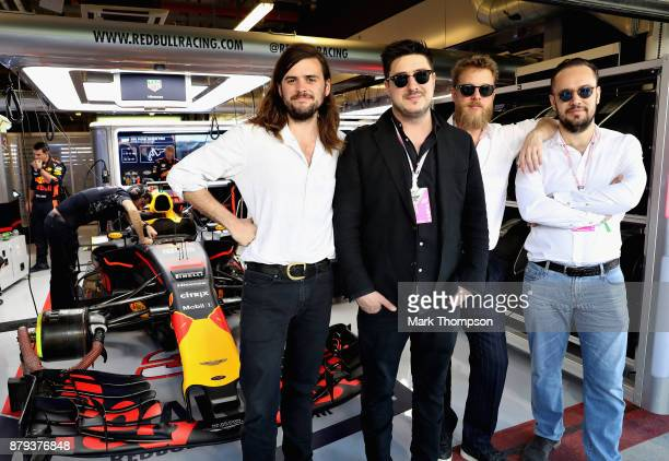 Mumford and Sons pose for a photo outside the Red Bull Racing garage before the Abu Dhabi Formula One Grand Prix at Yas Marina Circuit on November 26...