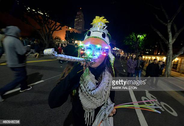 Mumli Gee celebrates the New Year at the Grand Park's NYELA event in downtown Los Angeles on December 31 2014 The free event which attracted nearly...