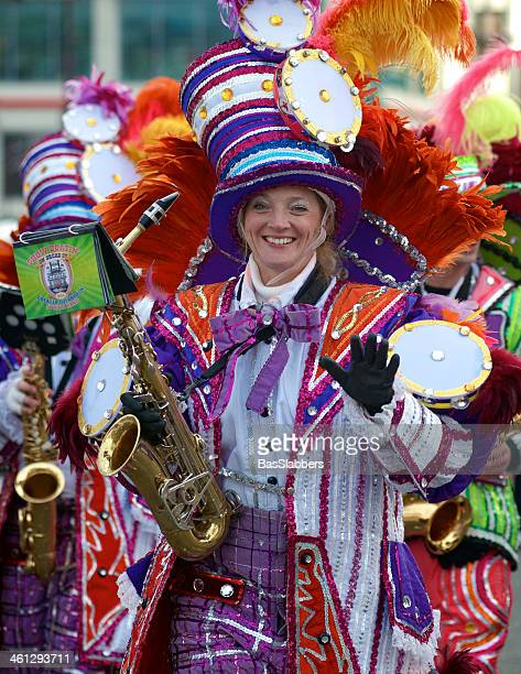 mummers strut at philly's new years day parade - mummers parade stock photos and pictures