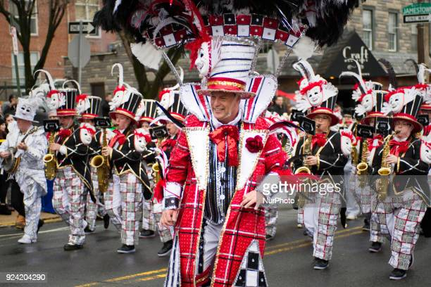Mummers strut down Main Street in the Manayunk neighborhood of Philadelphia PA during the annual Mardi Grass parade on February 25 2018