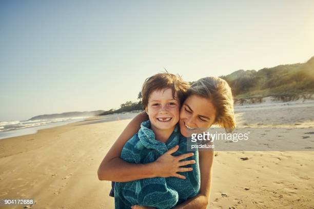 mummy and me down by the sea - wrapped in a towel stock pictures, royalty-free photos & images