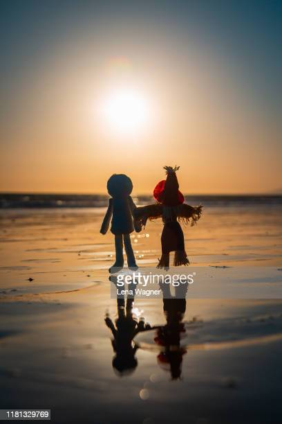 mummy and scarecrow sunset - lena spoof stock pictures, royalty-free photos & images