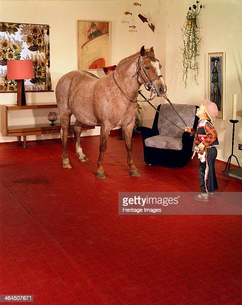 'Mummy wouldn't mind' 1963 In this advertising image a horse demonstrates the durability of a vinyl floor covering The image was shot in Michael...