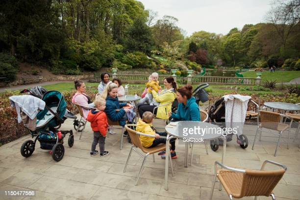 mums meeting in the park - medium group of people stock pictures, royalty-free photos & images