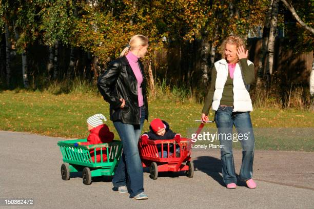 Mums with kids walking at Zoo.