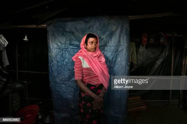 COX'S BAZAR BANGLADESH DECEMBER 02 Mumtaz Begum poses for a photo on December 2 2017 in Cox's Bazar Bangladesh She fled to Bangladesh shortly after...