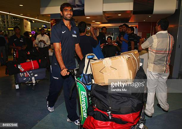Munaf Patel of India walks through the arrivals hall as the Indian cricket team arrive at Auckland International Airport on February 20 2009 in...