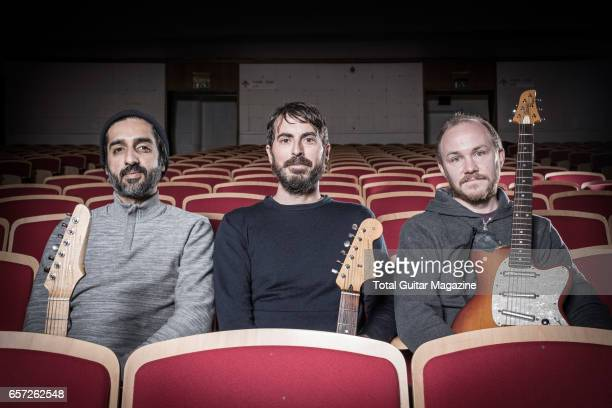 Munaf Rayani Mark Smith and Michael James guitarists with American postrock group Explosions In The Sky photographed before a live performance at the...