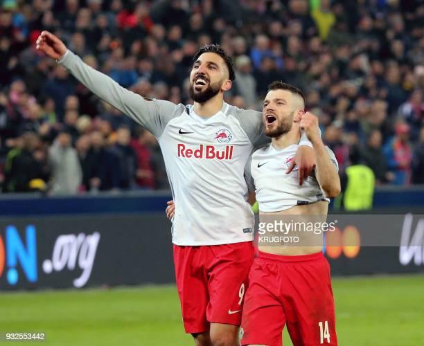 Munas Dabbur and Valon Berisha of FC Salzburg react after the Europa League Round of 16 second leg football match between FC Salzburg and Borussia...