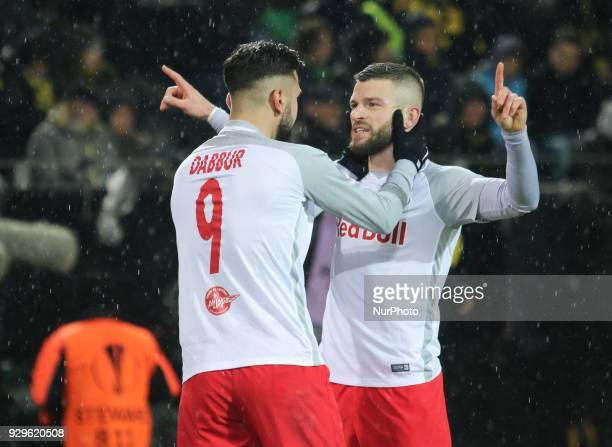 Munas Dabbur and Valon Berisha of Red Bull Salzburg celebrate during the UEFA Europa League Round of 16 match between Borussia Dortmund and FC Red...