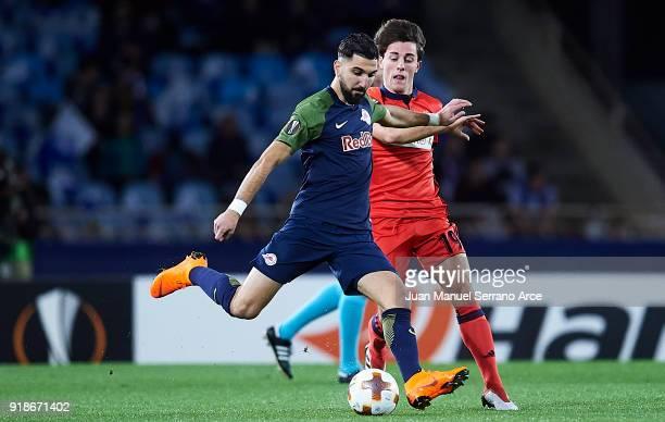 Munas Dabbur of FC Red Bull Salzburg being followed by Alvaro Odriozola of Real Sociedad during UEFA Europa League Round of 32 match between Real...