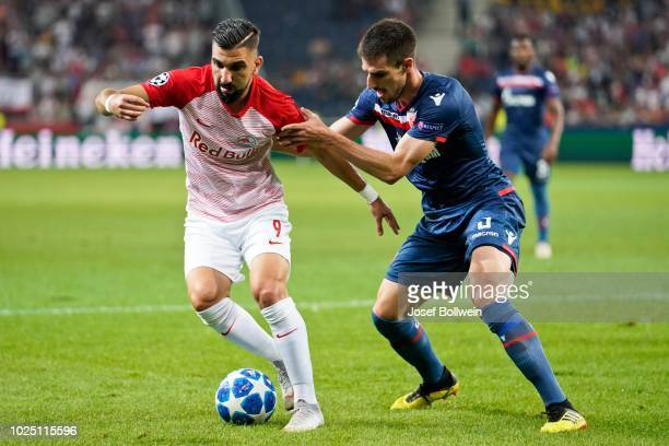 Munas Dabbur of FC Salzburg and Milos Degenek of Belgrade compete for the ball during the UEFA Champions League match between FC Salzburg v Red Star...