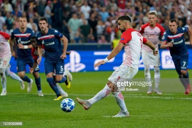 Munas Dabbur of FC Salzburg kicks the ball during the UEFA Champions League match between FC Salzburg v Red Star Belgrade at Red Bull Arena on August...